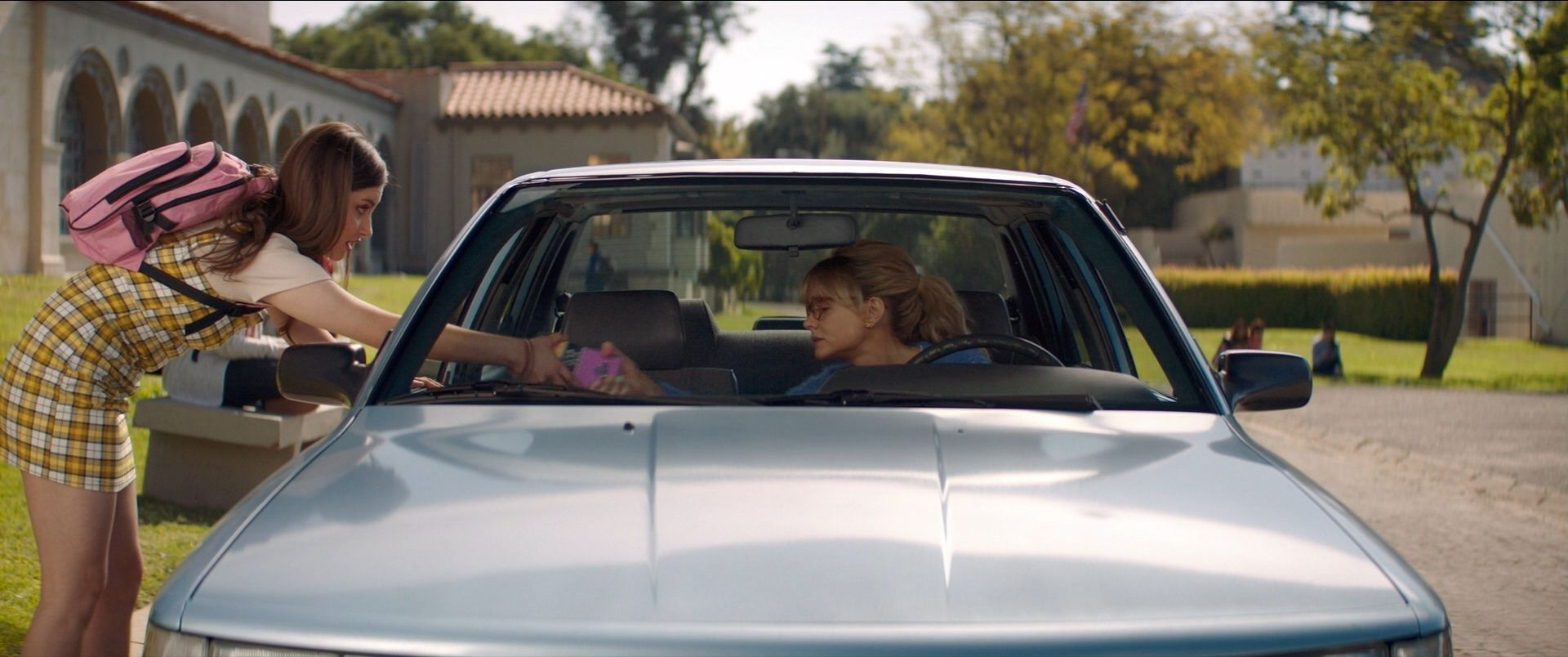 Cassie takes the phone of a teenage girl as she lures the girl into her car as part of her plot for revenge in Promising Young Woman